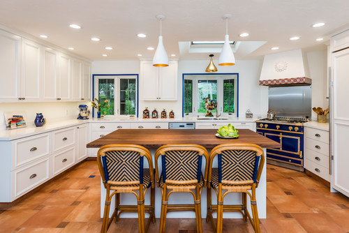 Kitchen featuring unconventional blue accents