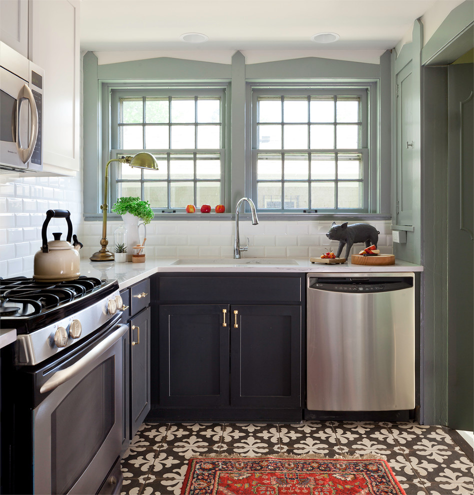Example of a small classic ceramic tile kitchen design in Denver with black cabinets, quartz countertops, white backsplash, stainless steel appliances, shaker cabinets, subway tile backsplash and no island