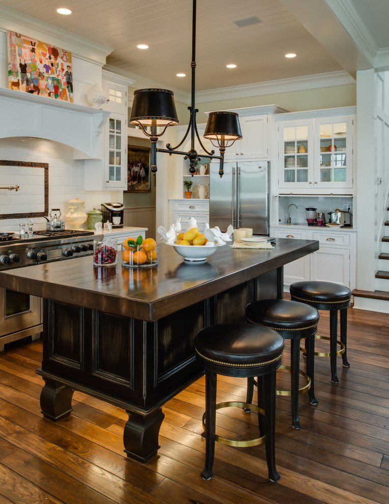 Inspiration for a timeless kitchen remodel in Detroit with recessed-panel cabinets, white cabinets, white backsplash and subway tile backsplash