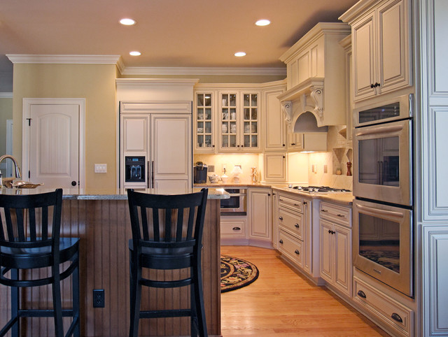 Warm Creams and Caramels Accentuate in Pinehurst traditional kitchen