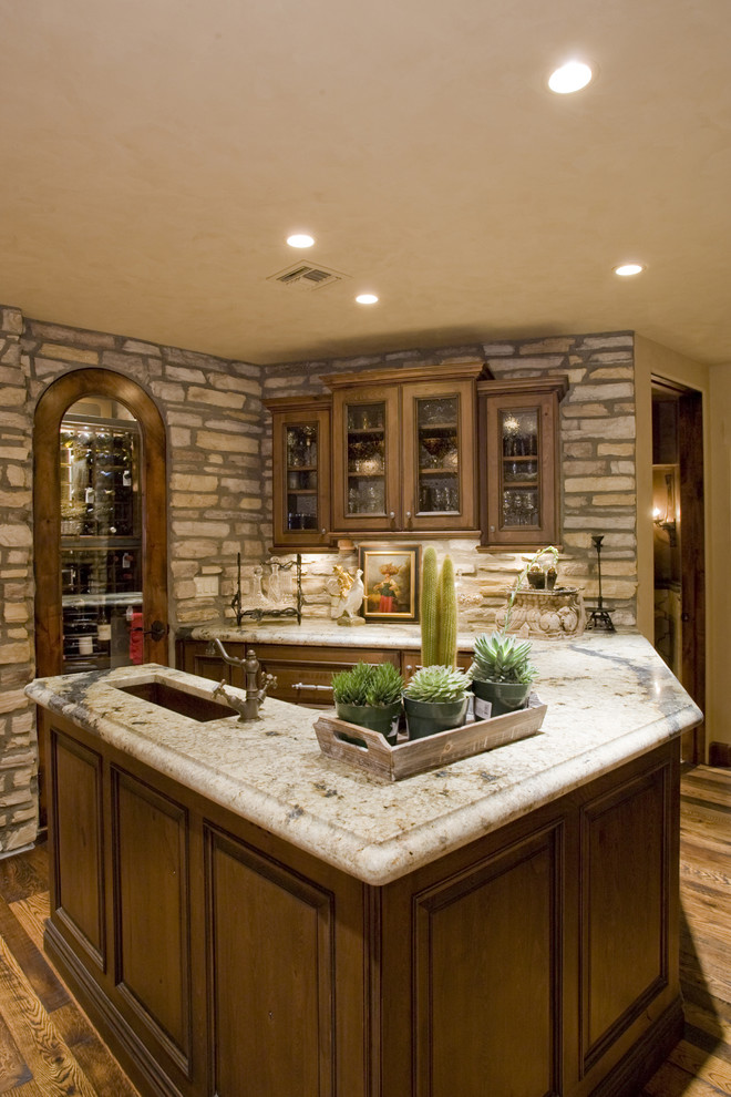 Example of a classic kitchen design in Phoenix with an undermount sink, glass-front cabinets and dark wood cabinets