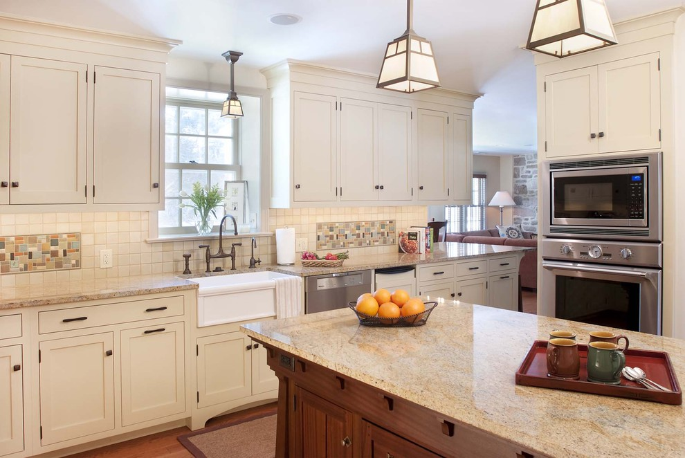 Inspiration for a craftsman kitchen remodel in Philadelphia with mosaic tile backsplash, stainless steel appliances, a farmhouse sink, multicolored backsplash and white cabinets