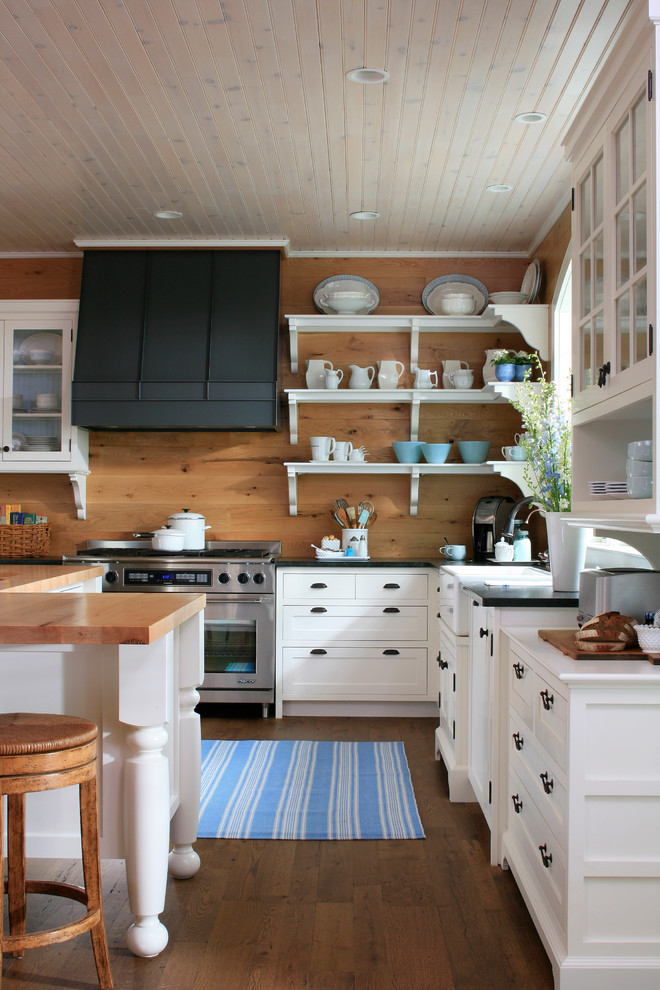 Inspiration for a timeless kitchen remodel in Other with open cabinets, stainless steel appliances, wood countertops, white cabinets and a farmhouse sink