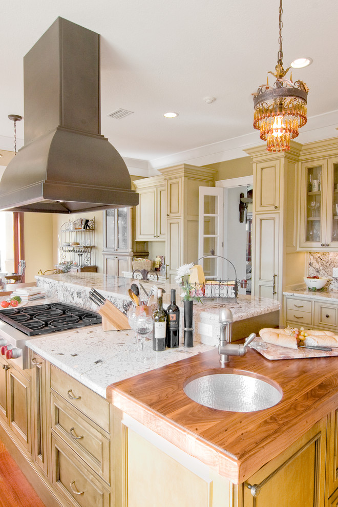 Kitchen - traditional kitchen idea in Other with beaded inset cabinets, wood countertops and an undermount sink