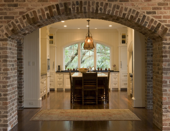 Kitchen beyond brick arch for Arch inside home designs