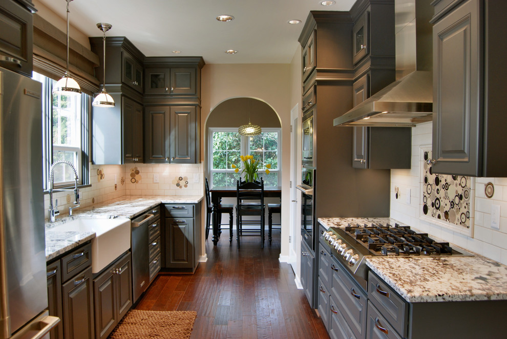 Enclosed kitchen - traditional galley enclosed kitchen idea in Other with a single-bowl sink, stainless steel appliances, raised-panel cabinets, gray cabinets, granite countertops, multicolored backsplash and ceramic backsplash