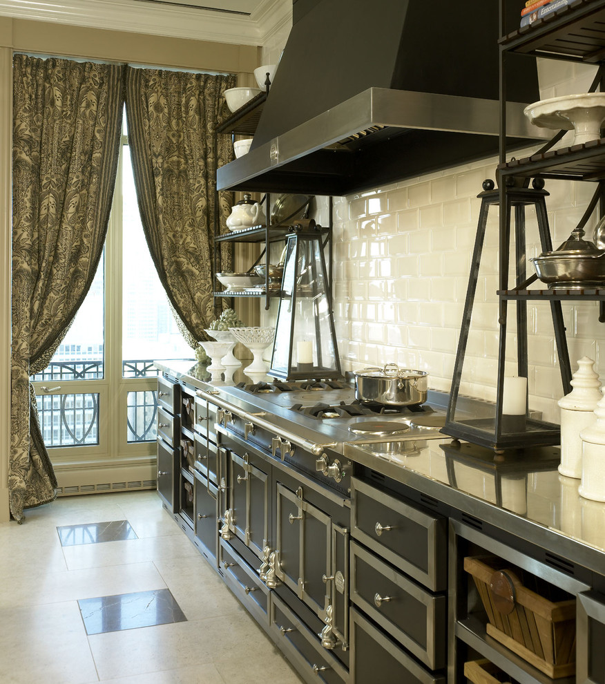 Inspiration for a timeless kitchen remodel in Other with stainless steel countertops, white backsplash, subway tile backsplash and black appliances