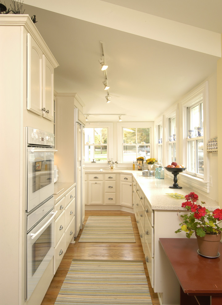 Enclosed kitchen - traditional enclosed kitchen idea in DC Metro with white appliances
