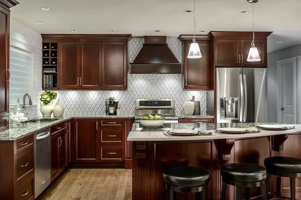Inspiration for a mid-sized timeless l-shaped light wood floor and brown floor enclosed kitchen remodel in Vancouver with stainless steel appliances, a double-bowl sink, shaker cabinets, dark wood cabinets, granite countertops, gray backsplash, ceramic backsplash and an island