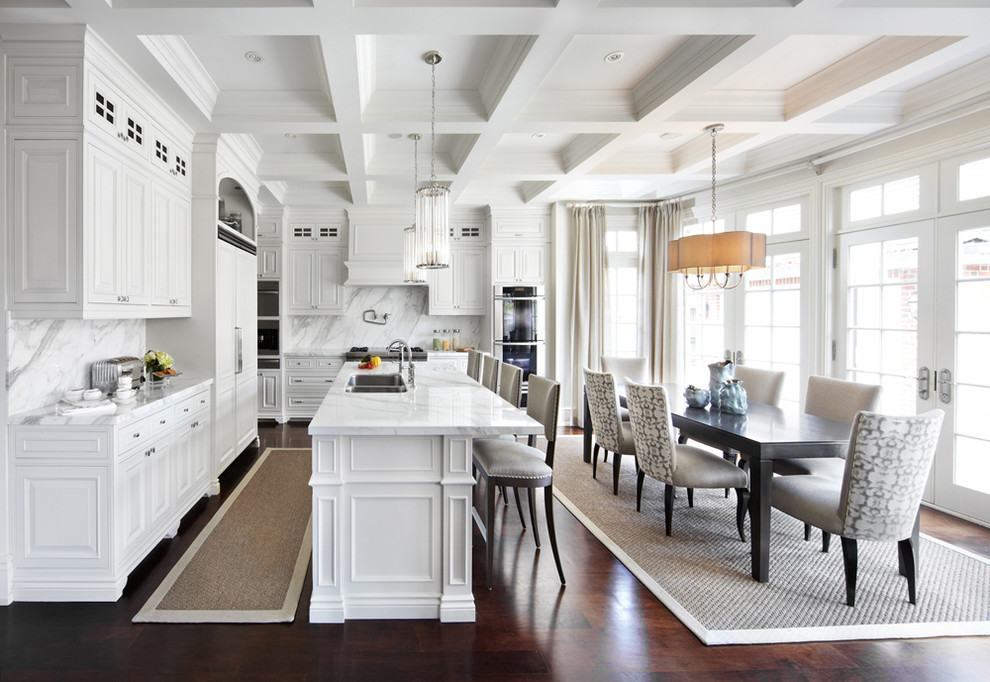 Eat-in kitchen - traditional eat-in kitchen idea in Dallas with a double-bowl sink, raised-panel cabinets, white cabinets, white backsplash and paneled appliances