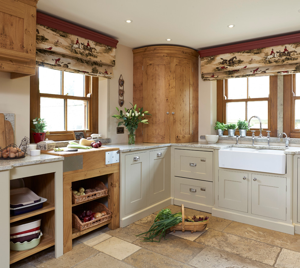 Cottage l-shaped kitchen photo in Other with a farmhouse sink, recessed-panel cabinets and beige cabinets
