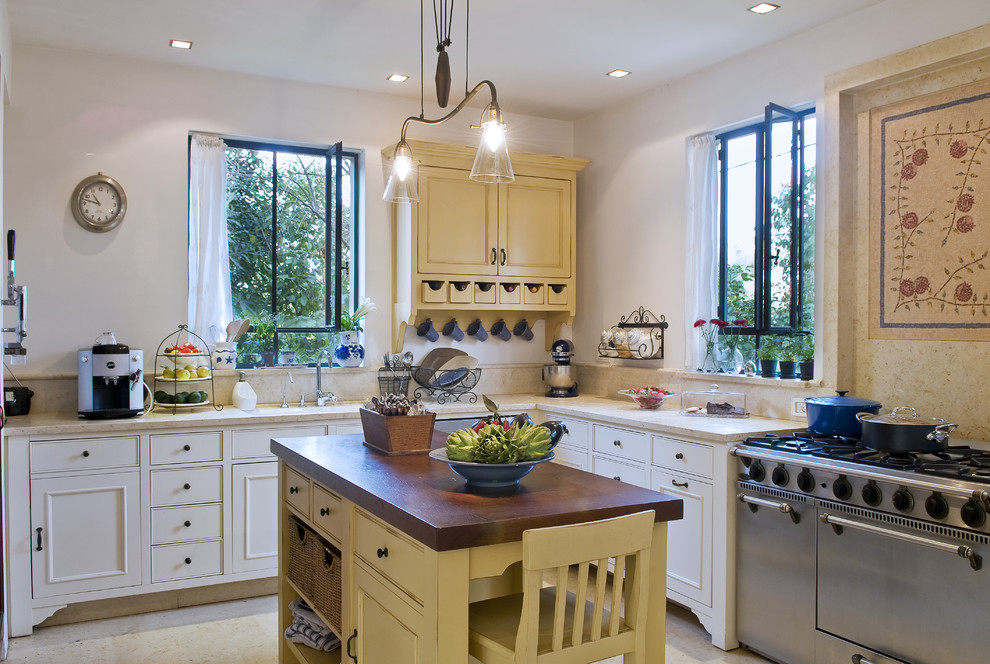 Inspiration for a timeless u-shaped open concept kitchen remodel in Tel Aviv with a drop-in sink, shaker cabinets and white cabinets