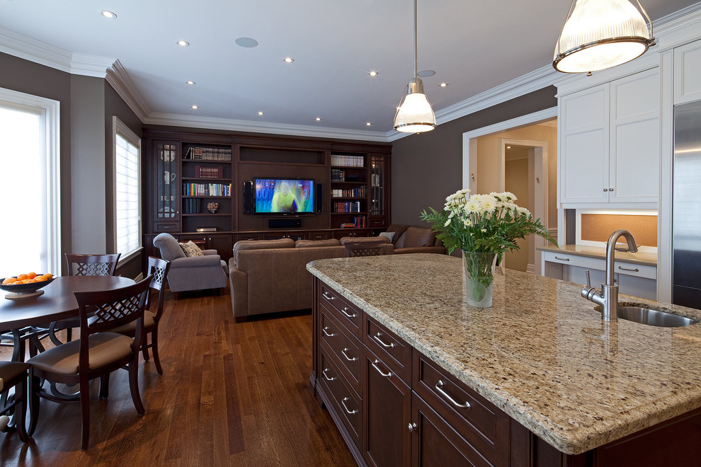 Elegant kitchen photo in Toronto with an undermount sink, recessed-panel cabinets, dark wood cabinets and granite countertops