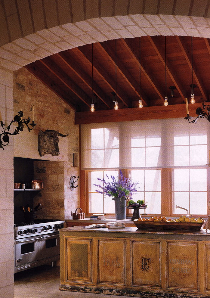 Example of a cottage kitchen design in New York with distressed cabinets