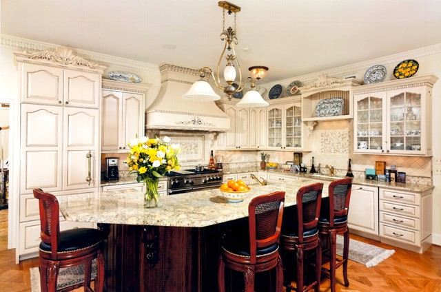 Traditional kitchen island with classic european styling for Traditional european kitchen