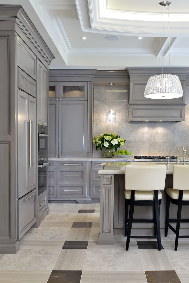 Kitchen - traditional kitchen idea in Toronto with recessed-panel cabinets, gray cabinets, gray backsplash, stone slab backsplash and an island