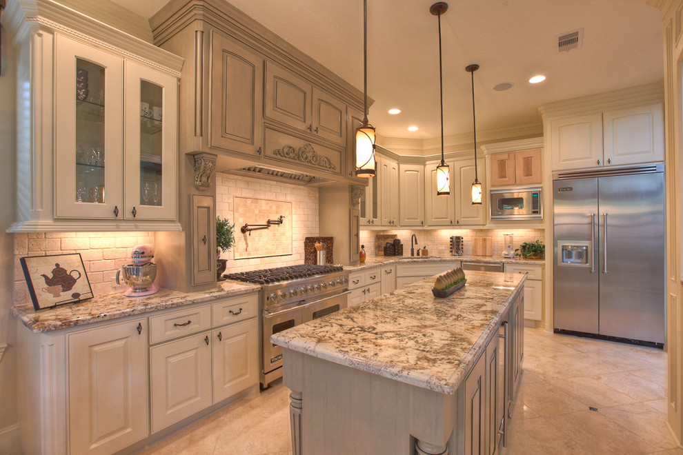Elegant kitchen photo in Houston with glass-front cabinets and stainless steel appliances