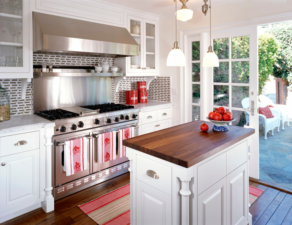 Kitchen - traditional kitchen idea in New York with wood countertops