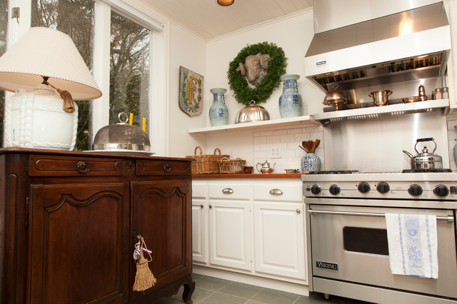 Kitchen - traditional kitchen idea in Portland with subway tile backsplash and wood countertops