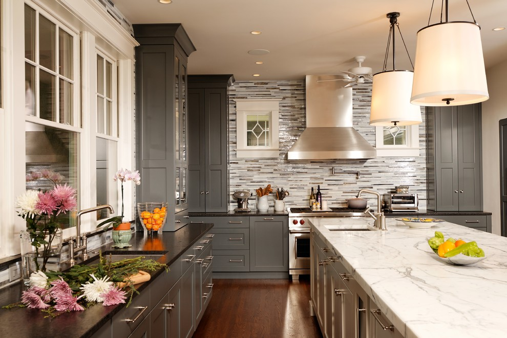 Inspiration for a timeless kitchen remodel in Chicago with an undermount sink, shaker cabinets, gray cabinets, multicolored backsplash, matchstick tile backsplash and stainless steel appliances