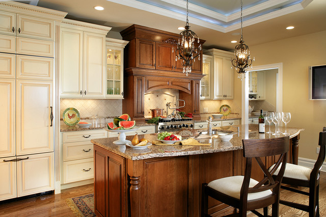 Traditional kitchen with contrasting island and hood