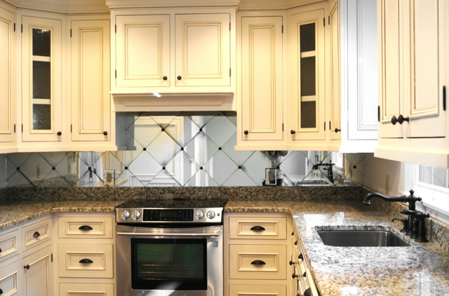 Traditional Kitchen with Cream Colored Cabinets and Mirror ...