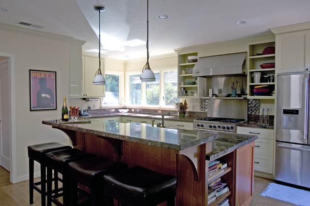 Traditional Kitchen with natural wood island and white painted cabinets traditional-kitchen