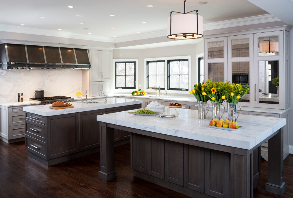 Large elegant l-shaped dark wood floor enclosed kitchen photo in DC Metro with an undermount sink, recessed-panel cabinets, gray cabinets, white backsplash, two islands, marble countertops, stainless steel appliances and stone slab backsplash