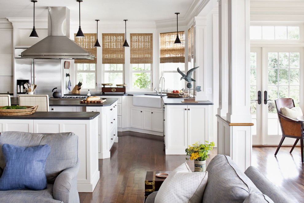 Open concept kitchen - traditional open concept kitchen idea in Miami with a farmhouse sink, white cabinets, stainless steel appliances and two islands