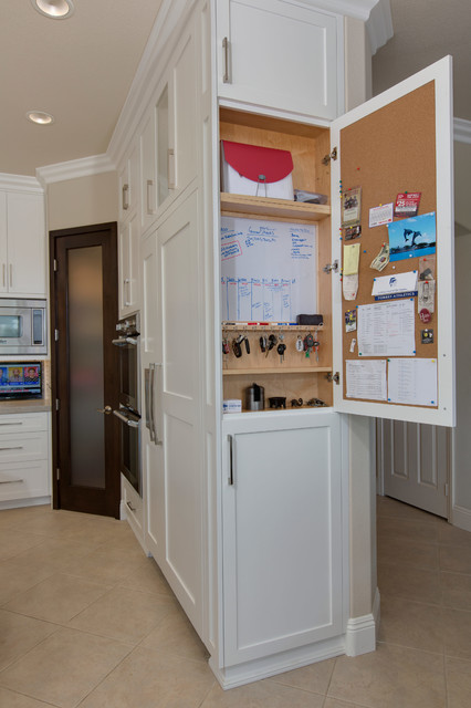 Example of a mid-sized transitional u-shaped porcelain floor kitchen pantry design in San Diego with an undermount sink, recessed-panel cabinets, white cabinets, quartzite countertops, gray backsplash, ceramic backsplash, stainless steel appliances and an island