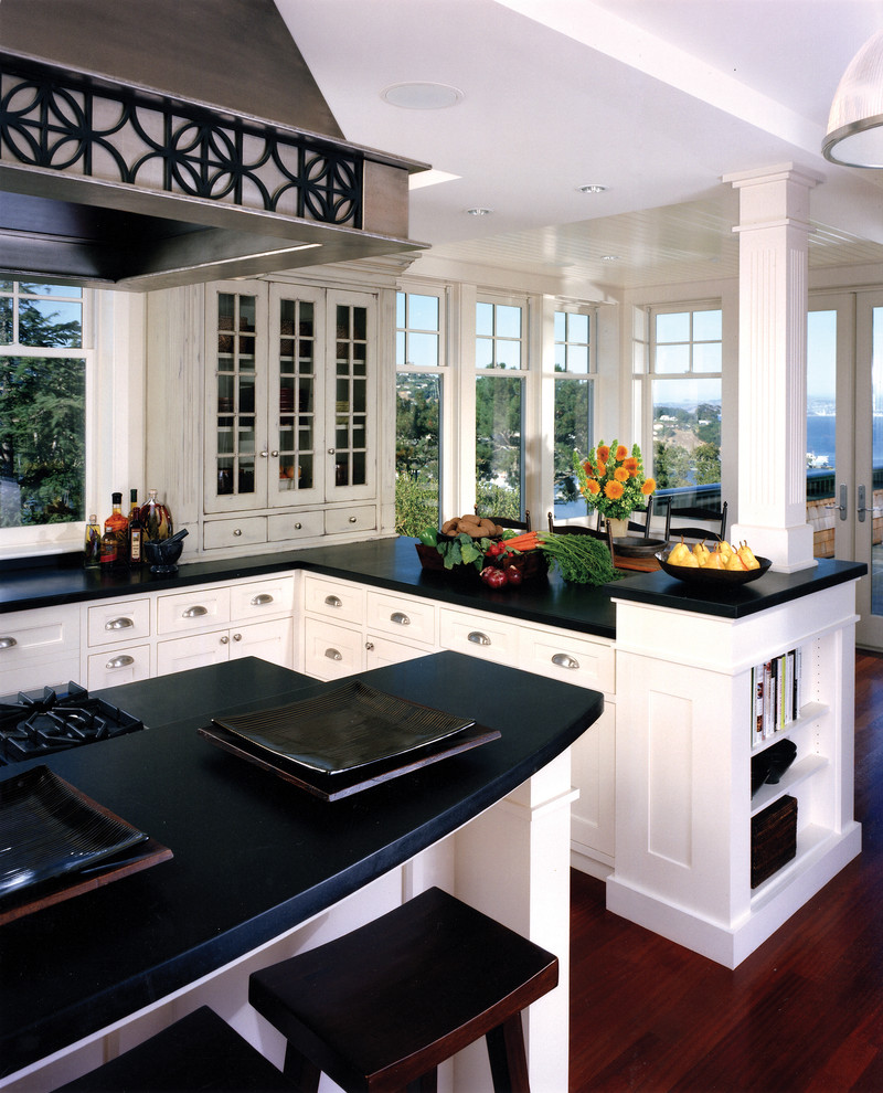 Example of a classic kitchen design in San Francisco with shaker cabinets and white cabinets