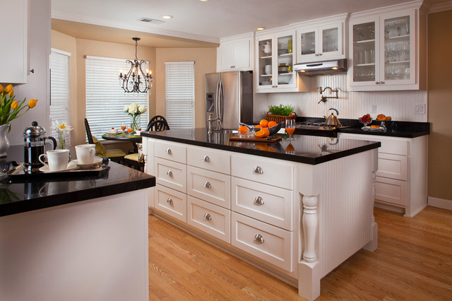 Traditional White Kitchen With Black Tops Traditional