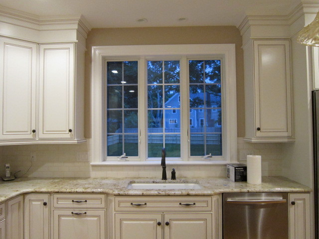 Traditional White Kitchen With Chocolate Glaze