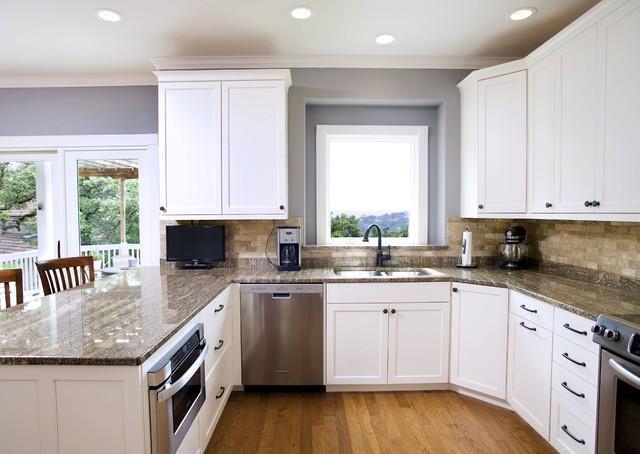 traditional white with stone backsplash kitchen