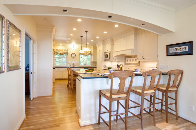 Inspiration for a timeless eat-in kitchen remodel in Portland with recessed-panel cabinets and white cabinets