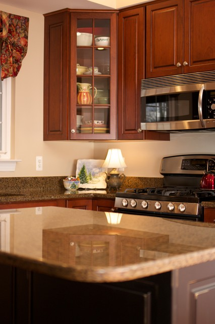 Transitional cherry kitchen with contrasting island in for Baltimore kitchen cabinets