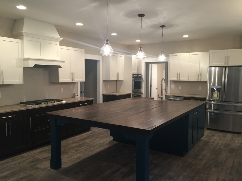 Transitional/contemporary kitchen with large island