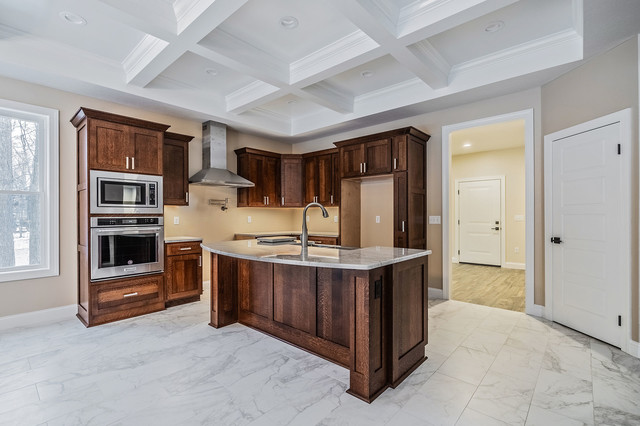 Large transitional l-shaped ceramic floor and multicolored floor eat-in kitchen photo in New York with an undermount sink, shaker cabinets, medium tone wood cabinets, quartz countertops, stainless steel appliances, an island and multicolored countertops