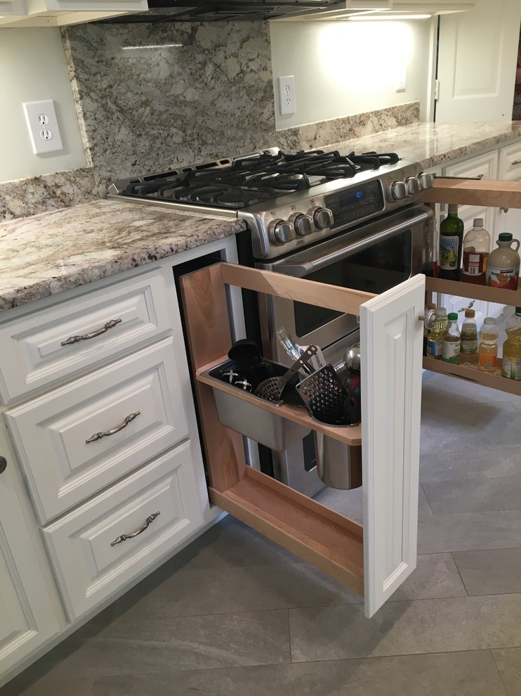 Inspiration for a large shabby-chic style u-shaped porcelain tile and gray floor eat-in kitchen remodel in DC Metro with an undermount sink, raised-panel cabinets, white cabinets, granite countertops, multicolored backsplash, stone slab backsplash, stainless steel appliances and an island