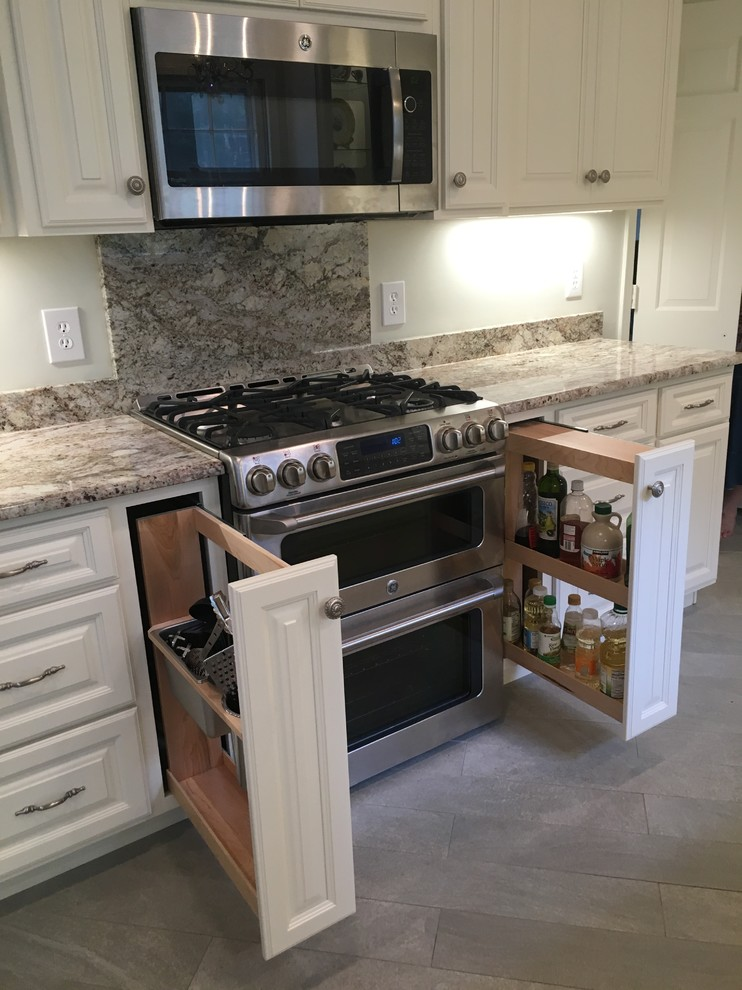Eat-in kitchen - large shabby-chic style u-shaped porcelain tile and gray floor eat-in kitchen idea in DC Metro with an undermount sink, raised-panel cabinets, white cabinets, granite countertops, multicolored backsplash, stone slab backsplash, stainless steel appliances and an island