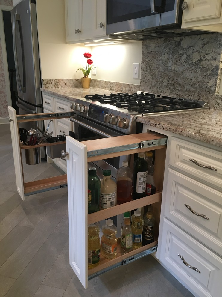 Large cottage chic u-shaped porcelain tile and gray floor eat-in kitchen photo in DC Metro with an undermount sink, raised-panel cabinets, white cabinets, granite countertops, multicolored backsplash, stone slab backsplash, stainless steel appliances and an island