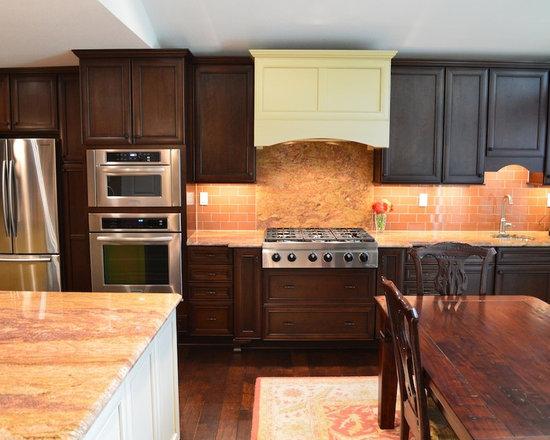 with dark wood cabinets orange backsplash and glass tile backsplash