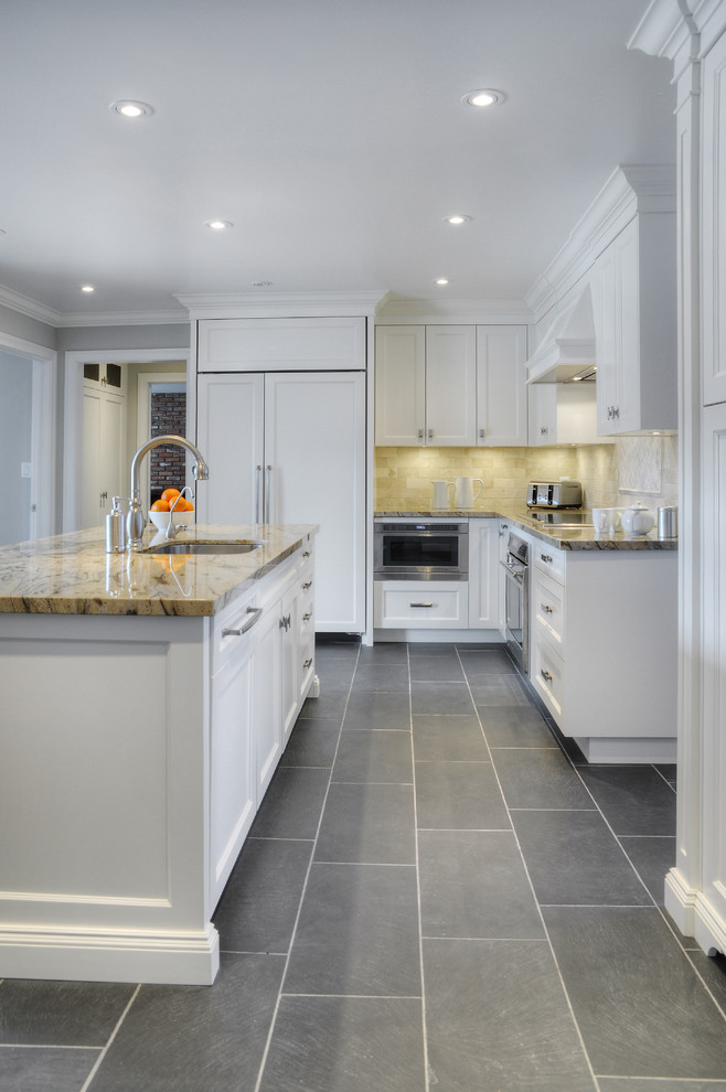 Example of a large transitional l-shaped slate floor eat-in kitchen design in Toronto with an undermount sink, recessed-panel cabinets, white cabinets, granite countertops, paneled appliances and an island