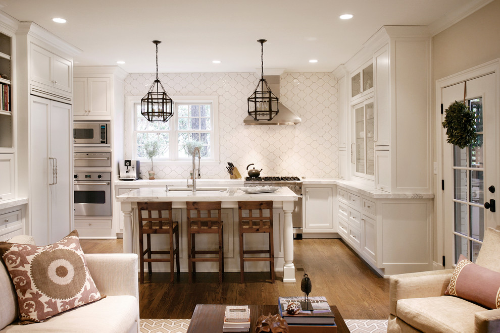 Inspiration for a transitional l-shaped open concept kitchen remodel in Atlanta with white cabinets