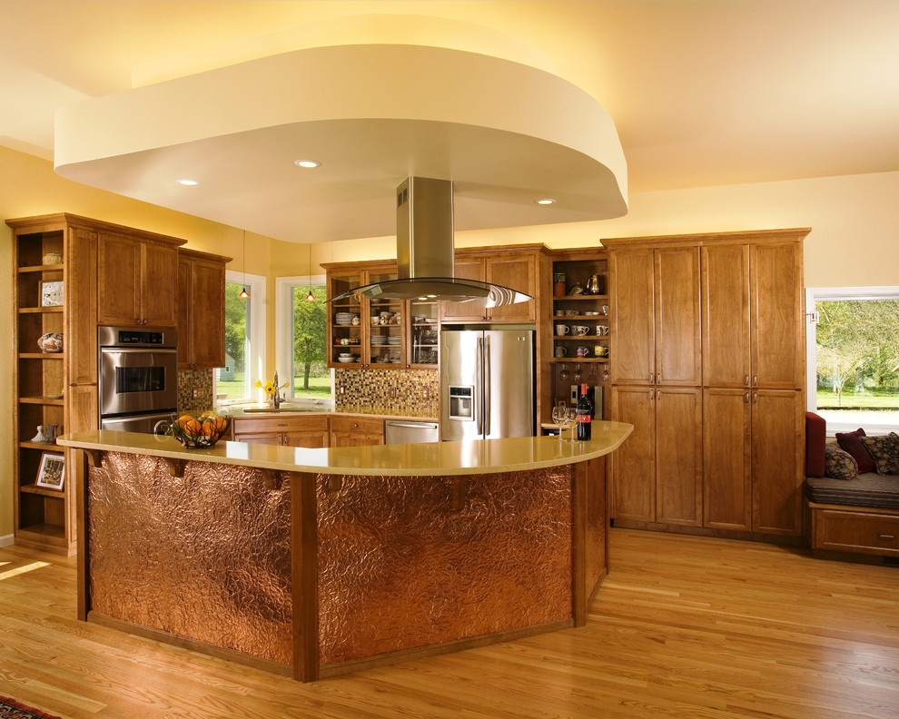 Inspiration for a transitional open concept kitchen remodel in Denver with recessed-panel cabinets, stainless steel appliances, medium tone wood cabinets and multicolored backsplash