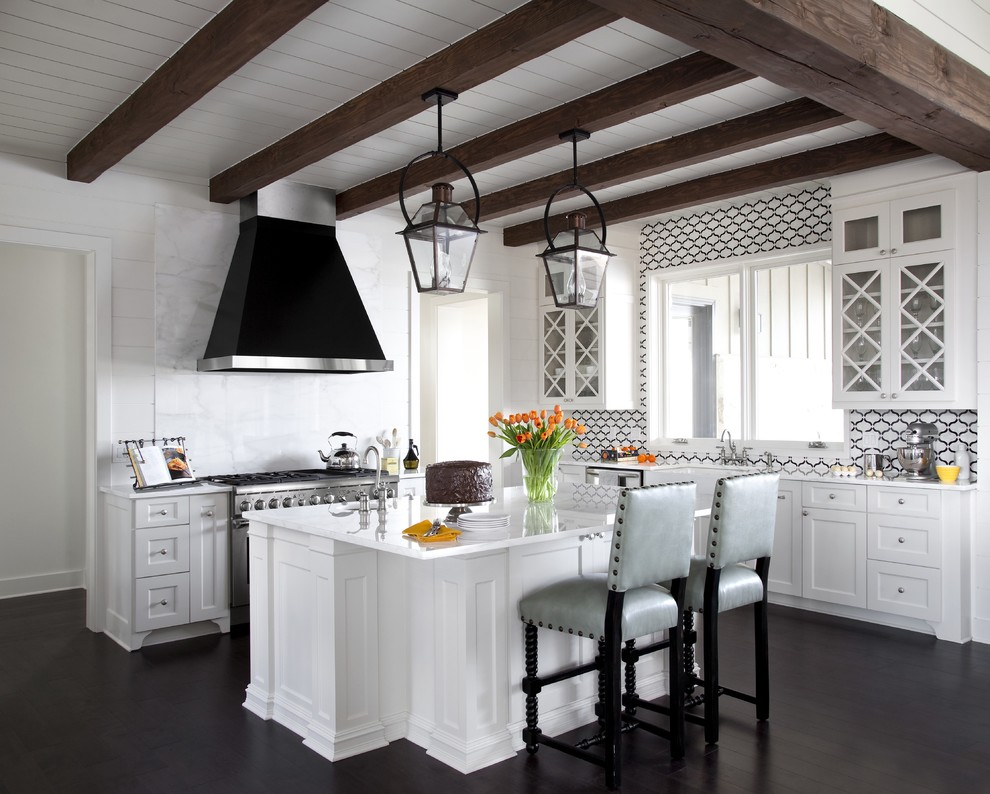 Inspiration for a large transitional l-shaped dark wood floor open concept kitchen remodel in New Orleans with a farmhouse sink, glass-front cabinets, white cabinets, an island, marble countertops, white backsplash, stone slab backsplash and stainless steel appliances