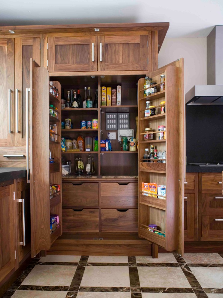 Inspiration for a transitional kitchen pantry remodel in Essex with shaker cabinets and medium tone wood cabinets