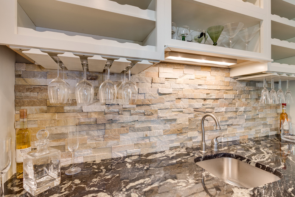 Example of a large transitional eat-in kitchen design in DC Metro with flat-panel cabinets, white cabinets, granite countertops, stainless steel appliances and an island