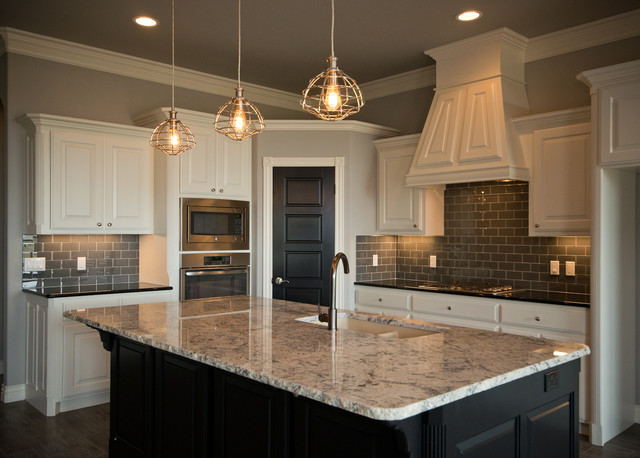 Kitchen With White Cabinets And Dark Island Transitional
