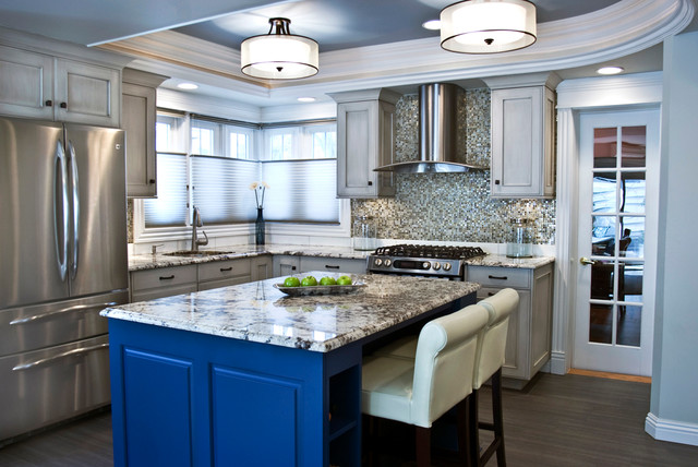 Transitional kitchen with painted cabinets, granite countertops, crown